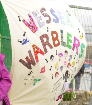 Wessex Warblers Banner (made by Susie and Gill) in the wind at St. Michael's Mount
