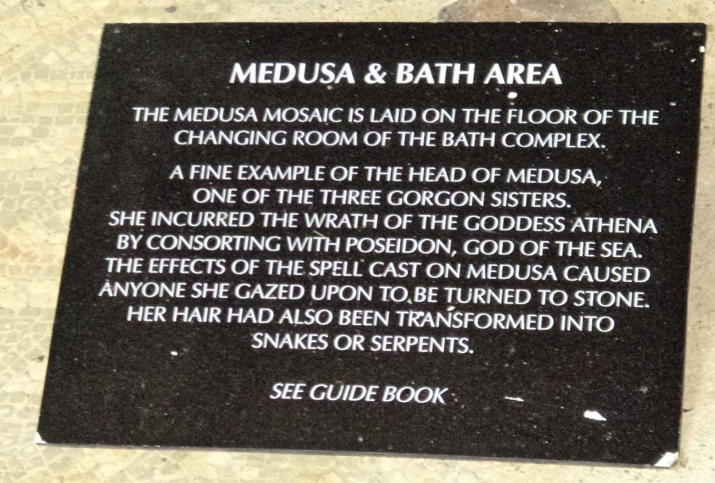 Sign by the bath house mosaic