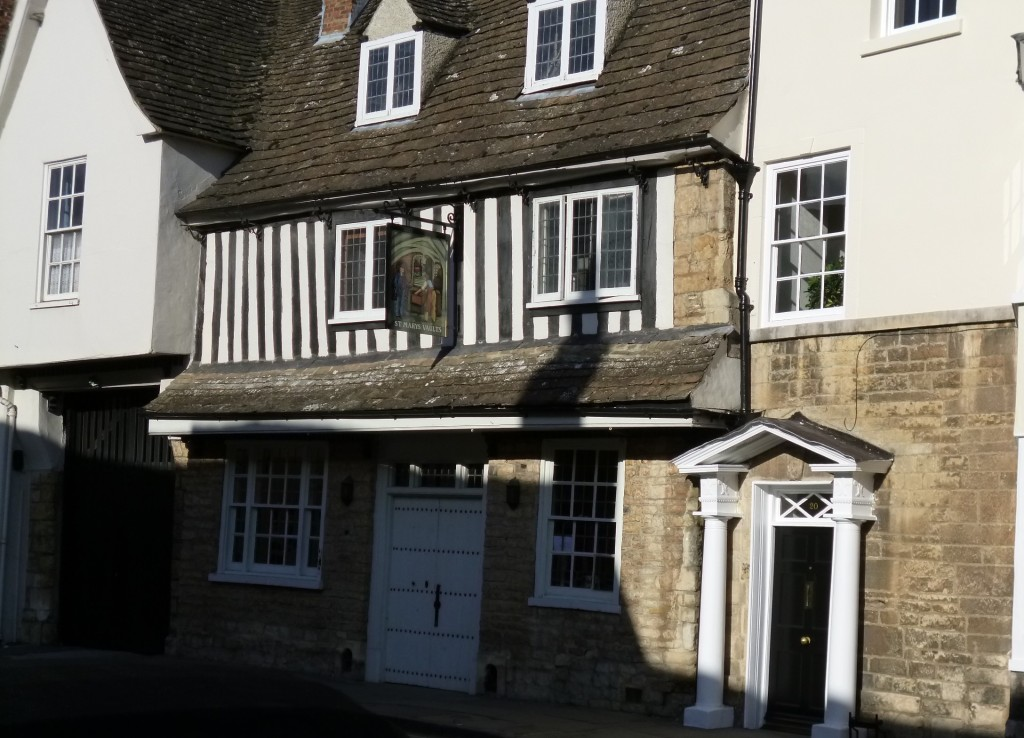 One of the older buildings - a coaching inn and the gate into the courtyard can be seen on the left.