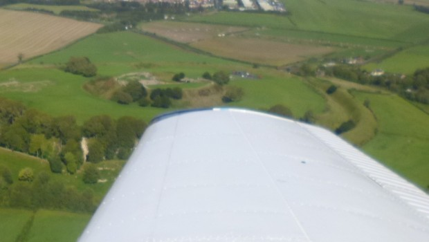 Slightly blurred picture of Stonehenge from the air.