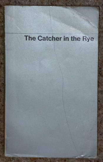 "Old copy of ""Catcher in the Rye"" by J.D. Salinger.  Bought about 1973!"