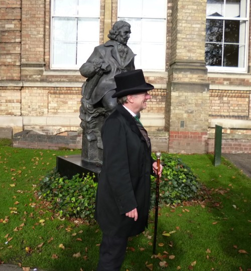 Our guide, standing in front of a statue of Erasmus Darwin