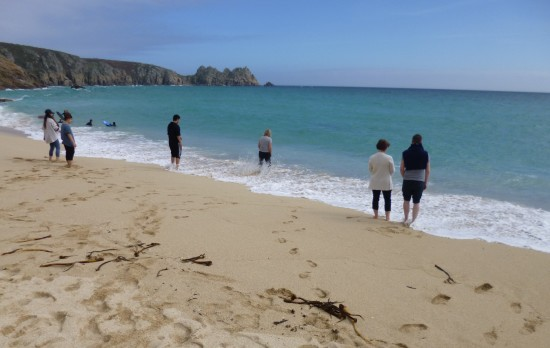 Paddling on Porthcurno Beach